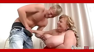 SSBBW Granny With Huge Boobs Satisfies A Young Guy