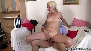 Skinny granny blonde takes two cocks