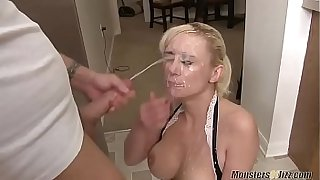 Blonde MILF takes fake gigantic cumshot